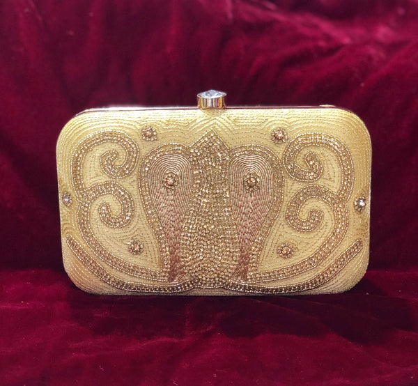 Designer clutch in gold with pattern work - Indian Wedding Bazar