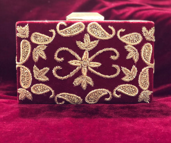 Sleek designer clutch with velvet and handwork