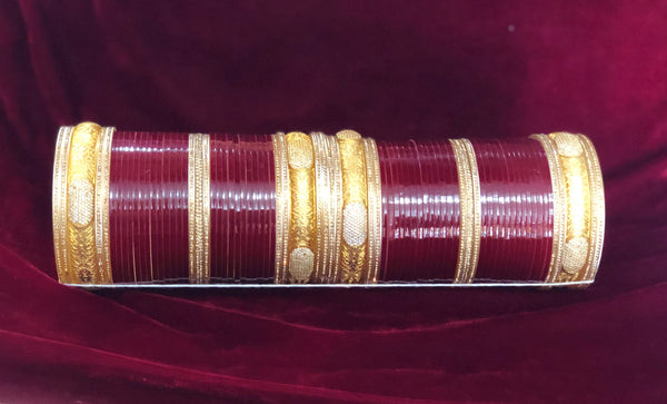Maroon chura with gold and AD kada