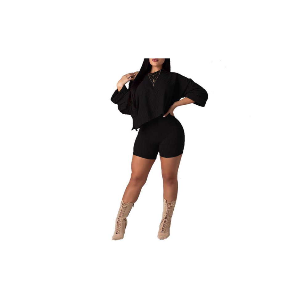 black knit asymmetrical quarter length sleeve top and high waist shorts