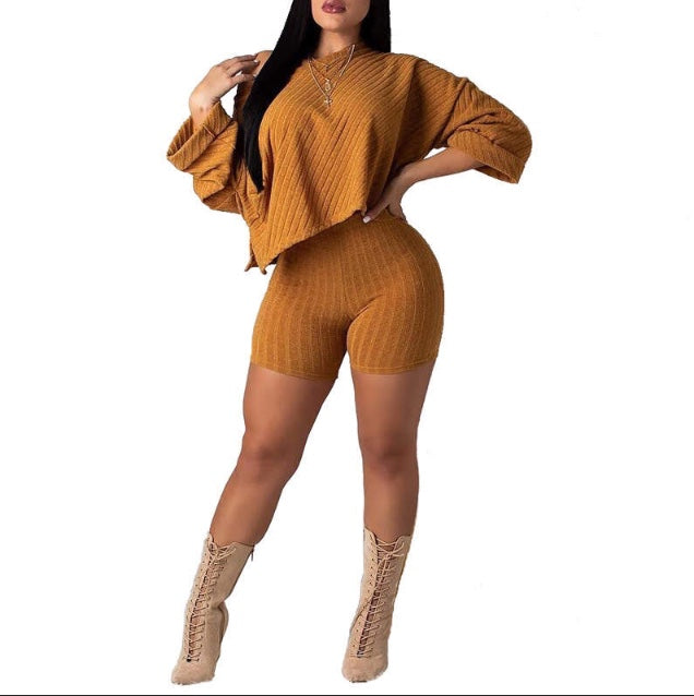 gold knit short set with asymmetrical top and high waist bottoms