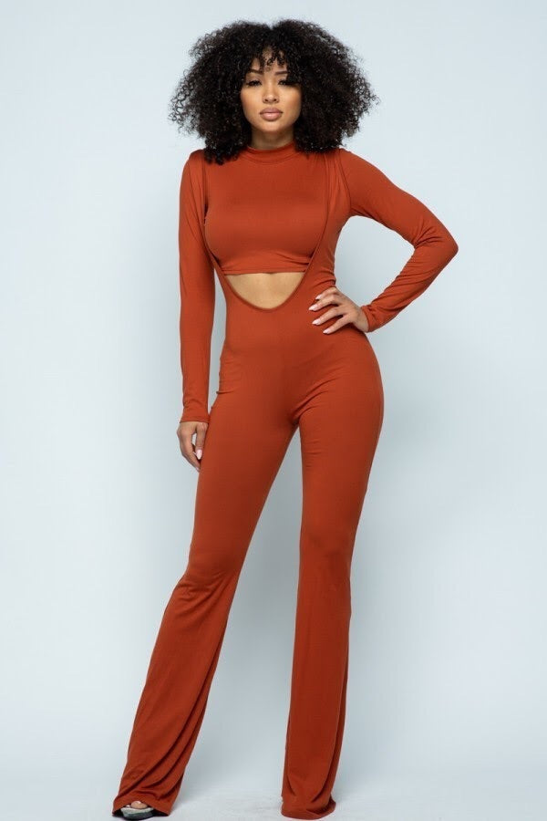 rust colored mock neck crop top and marching suspender style jumpsuit