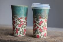 Roses green drippy travel mug with silicon lid and sleeve