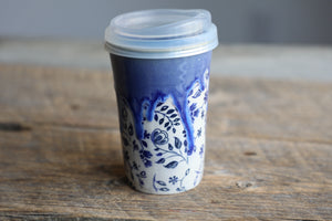 Blue flowers drippy travel mug with silicon lid and sleeve 12 oz