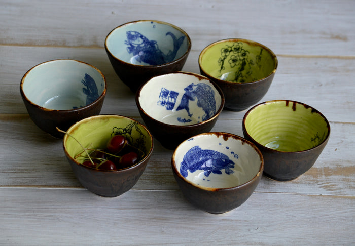 set of 7 small bowls with fish and cherry tree patterns