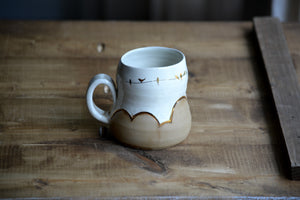 "Milk glazed ""birds on a wire"" mug with 23k gold 16 onces"