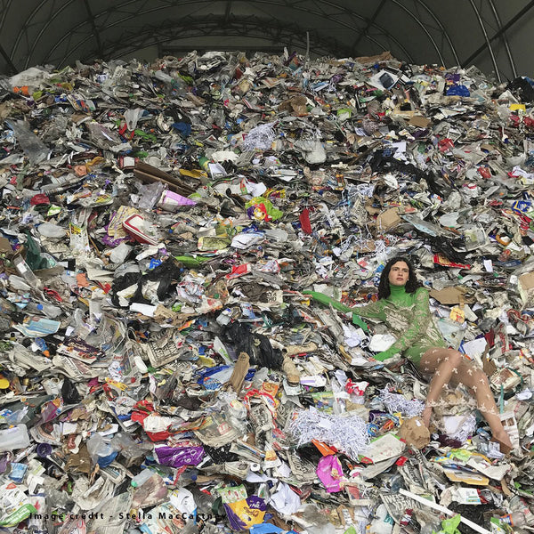 Fashion Model on top of rubbish