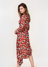 3/4 sleeve dress with asymmetric hem in a Red animal print
