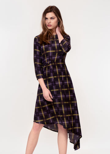 3/4 sleeve dress with asymmetric hem in a black ground yellow plaid print