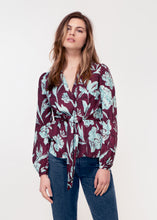 Long sleeve, V neck tie front top in purple and turquoise snake print