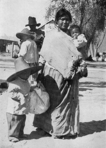 Mexico – Mother carrying her toddler using a sling similar to the pouch. National Geographic Magazine, Volume 31 (1917), page 559