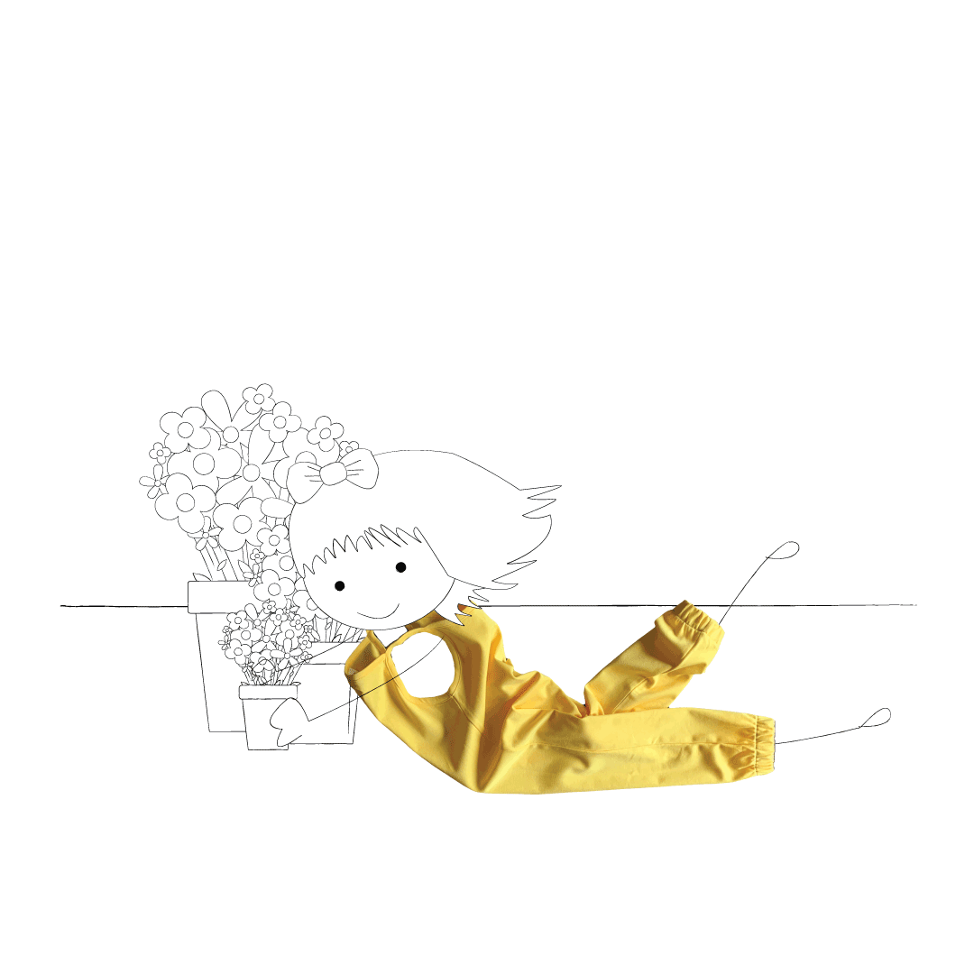 Children's clothing brand | Little Pegs Little girl laying on the floor in a yellow jumpsuit, potting flowers in the garden