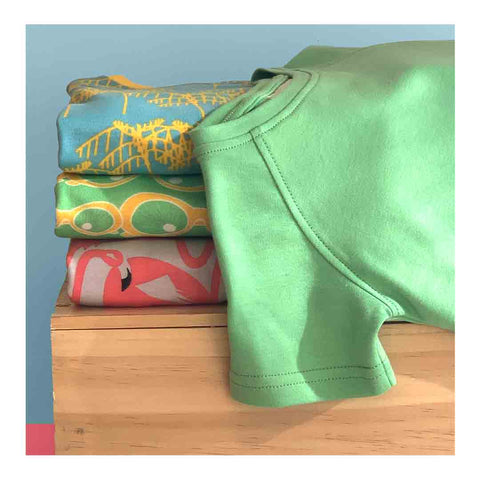 Children's clothing brand | Little Pegs | Pile of t-shirts made from high quality fabric and sewn with care
