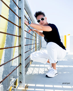 Tomboy-Style-Black-Friday-Santa-Monica-Rooftop-California-Dreaming-Black-T-shirt-White-Ripped-Jeans-White-Sunglasses-Ocean-Theme-Blue-and-White-Watch-Short-Hair-White-Puma-Sneakers-Gender-Neutral-Nonbinary-Androgynous-Summer-Fashion