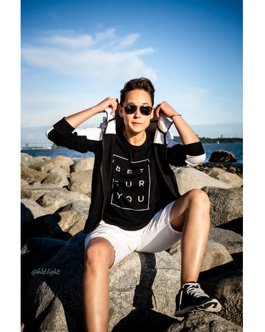 Tomboy-Model-Sunny-Beach-Tomboy-Style-Short-Hair-Aviator-Sunglasses-Black-and-White-Ralph-Lauren-Hoodie-Black-T-shirt-Be-You-Puzzle-White-Armani-Shorts-Silver-Bracelet-Black-Under-Armour-Sneakers-Gender-Neutral-Androgynous-Fashion