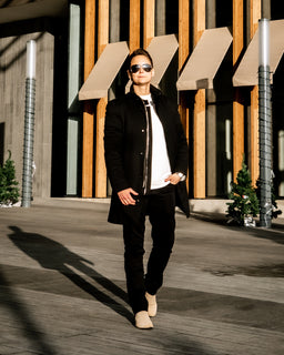 Tomboy-Style-Outfit-Fall-Winter-Fashion-Long-Black-Coat-Black-Motto-Jacket-White-Lightweight-Sweatshirt-Black-Guess-Pants-Beige-Chelsea-Boots-Silver-Watch-Silver-Black-Bracelet