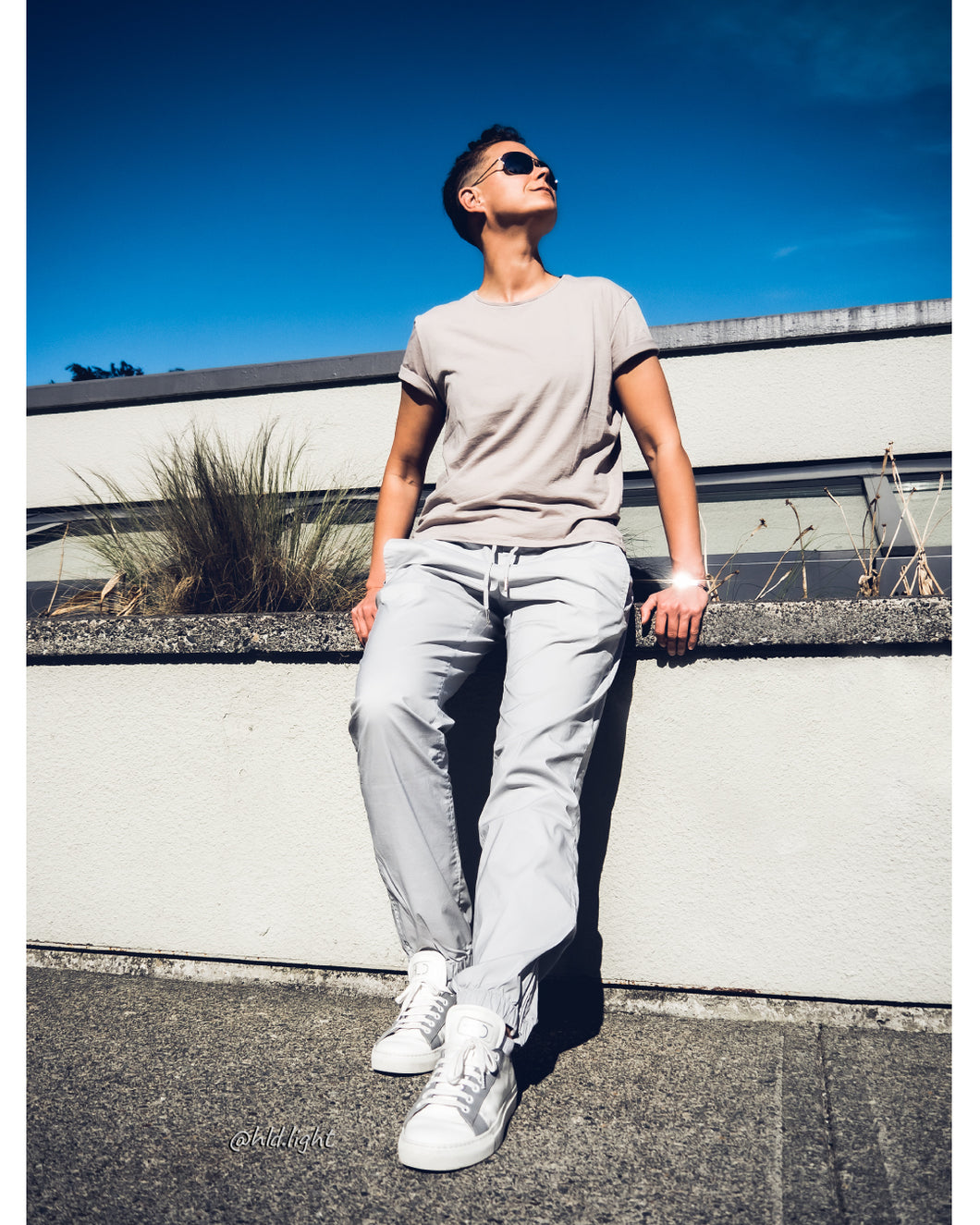 Tomboy-Style-Short-Hair-Fade-Khaki-T-shirt-Light-Grey-Joggers-White-Sneakers-Silver-Bracelet-Gender-Neutral-Androgynous-Summer-Fashion