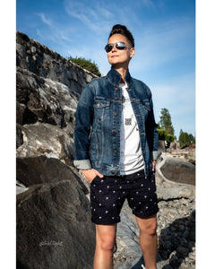 Tomboy Model, Sunny Beach, Short Hair Fade, Aviator Sunglasses, Blue Jean Jacket, Palm Trees White Graphic T-Shirt, Palm Trees Print Navy Blue Shorts, White Sneakers, Silver Bracelet, Gender Neutral, Androgynous, Summer Fashion