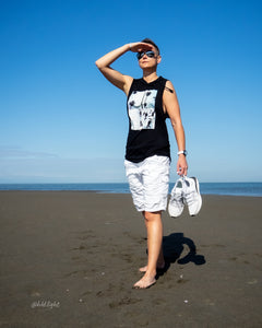 Tomboy-Model-Sunny-Beach-Tomboy-Style-Short-Hair-Aviator-Sunglasses-Black-Sleeveless-Hoodie-White-Armani-Shorts-Silver-Bracelet-White-Puma-Sneakers-Gender-Neutral-Androgynous-Fashion
