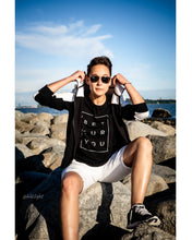 Load image into Gallery viewer, Tomboy Model, Sunny Beach, Tomboy Style, Short Hair, Aviator Sunglasses, Black and White Hoodie, Black T-shirt Be You Puzzle, White Shorts, Silver Bracelet, Black Sneakers, Gender Neutral, Androgynous Fashion