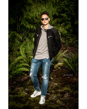 Load image into Gallery viewer, Tomboy-Style-Short-Hair-Fade-Aviator-Sunglasses-Black-Bomber-Jacket-Grey-Short-Sleeve-Hoodie-Black-T-Shirt-Blue-Ripped-Jeans-White-Sneakers-Silver-Bracelet-Gender-Neutral-Androgynous-Fall-Fashion