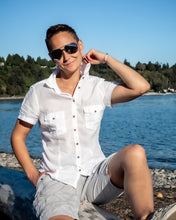 Load image into Gallery viewer, Tomboy-Style-Fashion-Outfit-Tomboy-Hairstyle-White-Short-Sleeve-Button-Up-Shirt-Grey-Armani-Shorts-Vans-Boat-Shoes-Aviator-Sunglasses-Silver-Bracelet-Gender-Neutral-Androgynous-Fashion