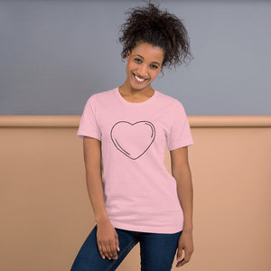 Smiling black young millennial woman posing wearing blue jeans and personalized Valentine's Day T-Shirt in pink colour.