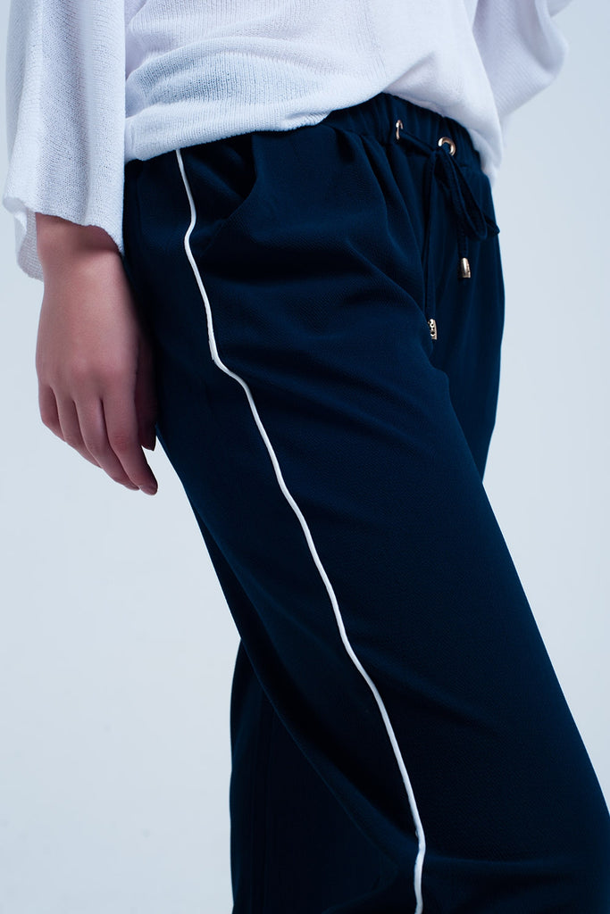 Navy blue pants with white line detail