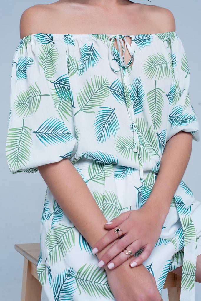 White jumpsuit with tropical print