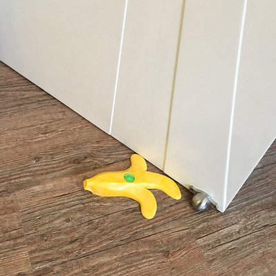 Don't Slip You'll Lose The Race Banana DoorStopper