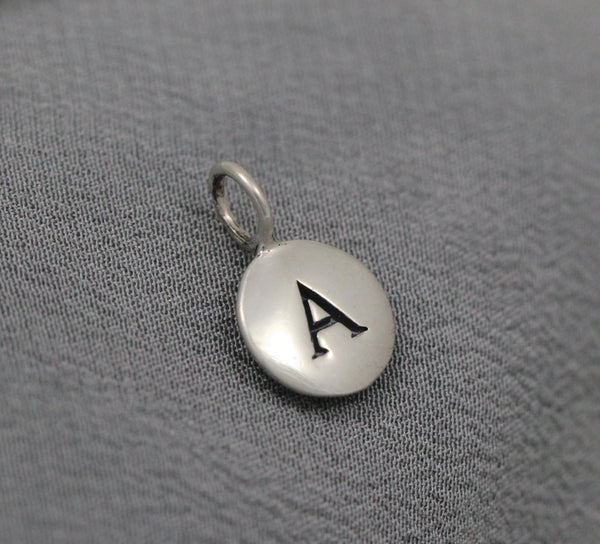 round disc initial charm in silver