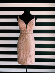 Picture of the dress described in the post. It is a blush short dress and it is on a black mannequin in front of XO's Striped wall.
