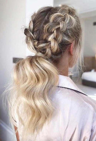 Girl with 2 double dutch braids leading down to a full and curled pony tail. She is facing away, so that you can see the whole hairstyle.