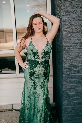 prom dress with a deep v and green lace