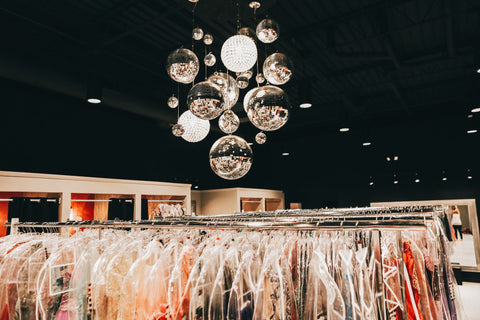 Above view of XO's dress racks. You can see the multi disco ball chandelier at the top of the image.