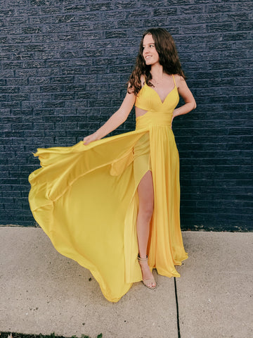 yellow prom dress with a slip and cut outs