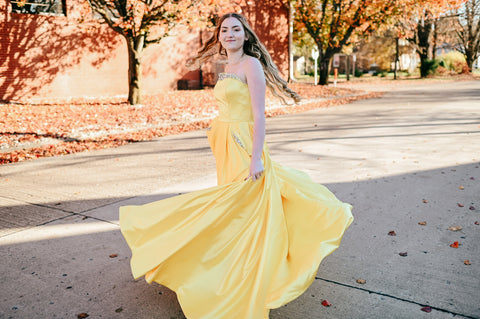 girl wearing a yellow ball gown