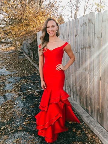 red off the shoulder prom dress with a ruffle mermaid skirt