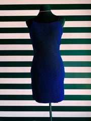 Navy sparkle, sheath short dress. It is on a black mannequin, in front of XO's striped wall.