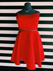 Image of the dress described in the post. It's a plus size, red A-Line short dress with beaded waistline. It is on a black mannequin, in front of XO's striped wall.