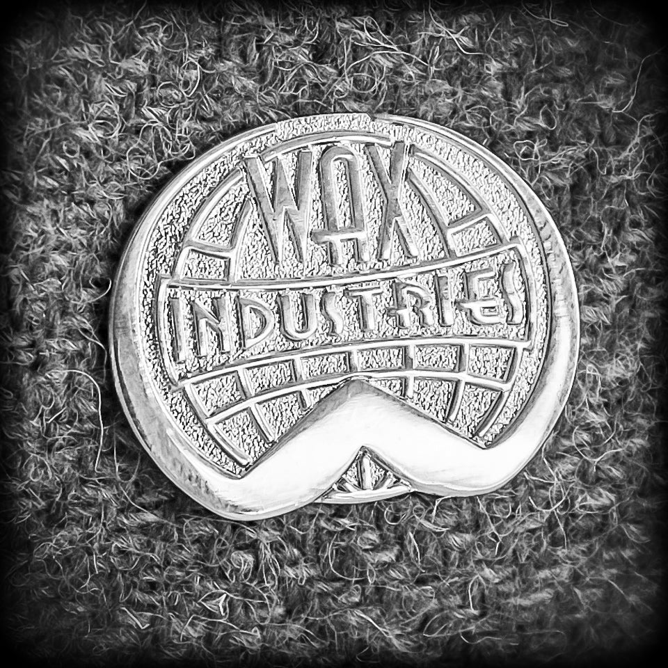 Wax Industries Lapel Badge