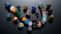 Various flameworked glass beads by Becky Congdon.