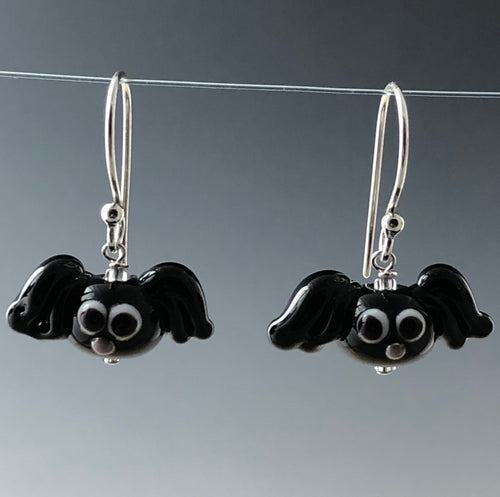 Cute small glass black bats with black/white eyes and purple noses.  They hang from simple sterling silver earrwires.  Zoom ready earrings! Happy Halloween!