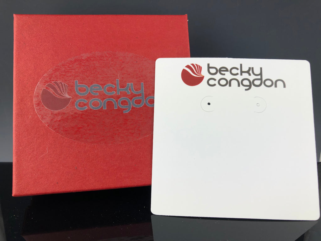 Red square cotton jewelry box with Becky Congdon's logo and white earring card with logo at top.