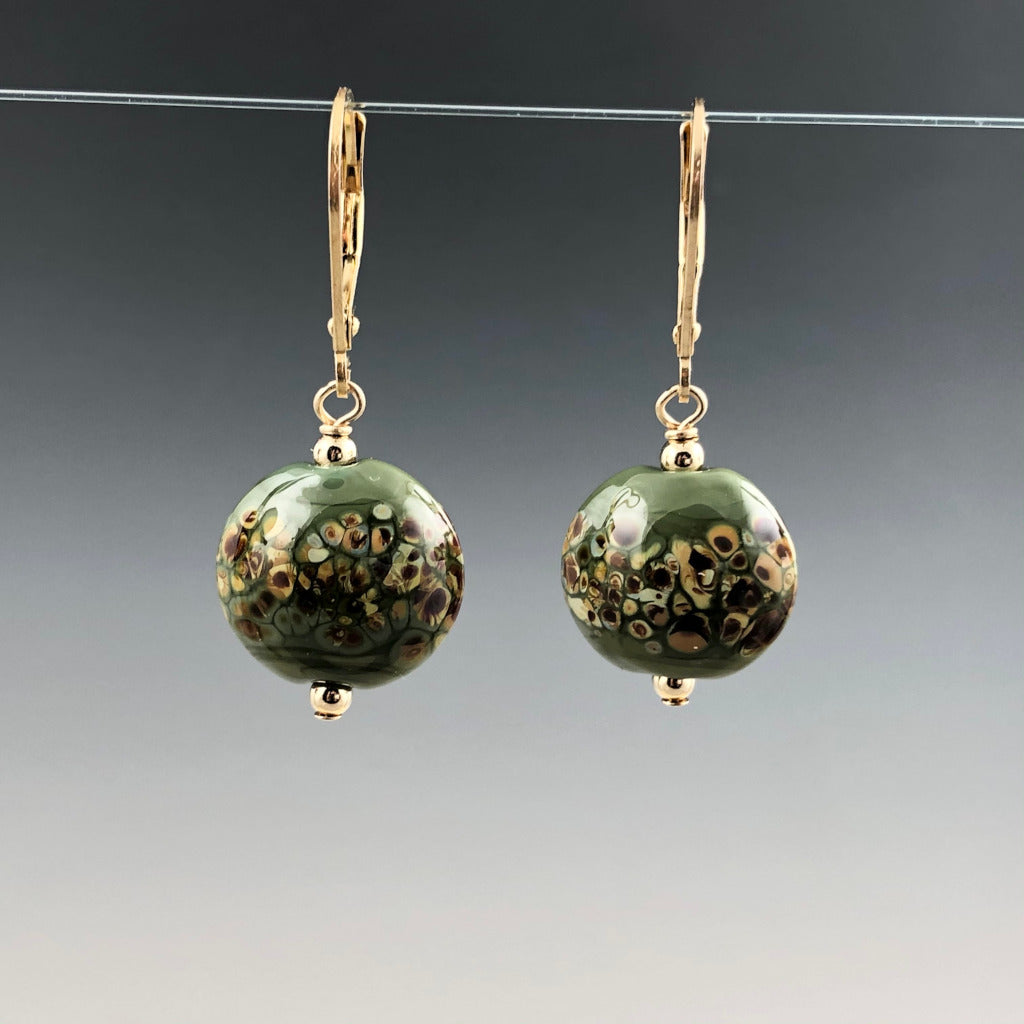 "My handmade flameworked glass beads are olive green with random tiny dots of shades of brown (glass frit). I think it looks flowers. The beads are lentil in shape (.5"" widest) and assembled with gold filled round beads and simple gold filled leverbacks. The earrings dangle about 1.25""."