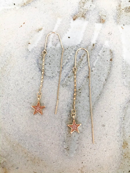 gold star pull through earrings