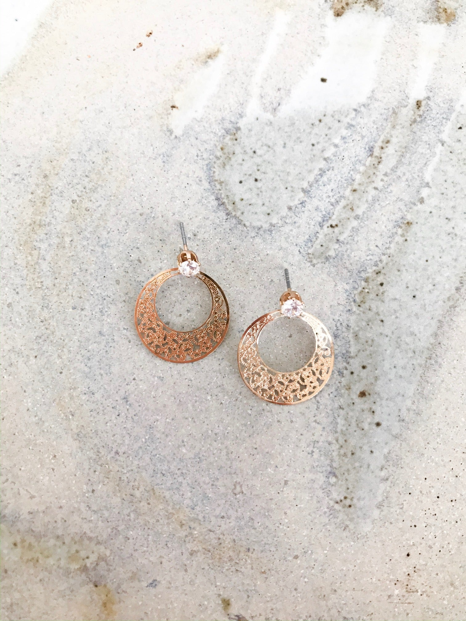 Simple and dainty gold stud earring