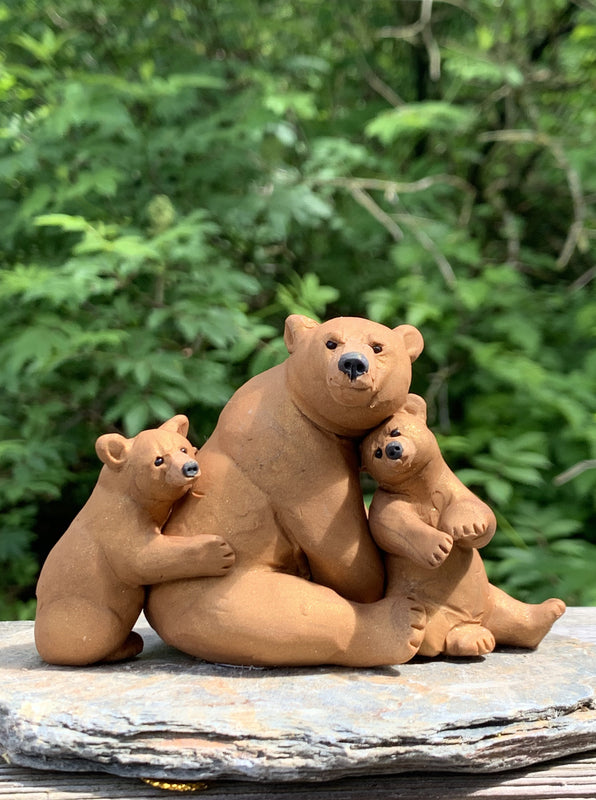 Brown Bear With Cubs Sitting