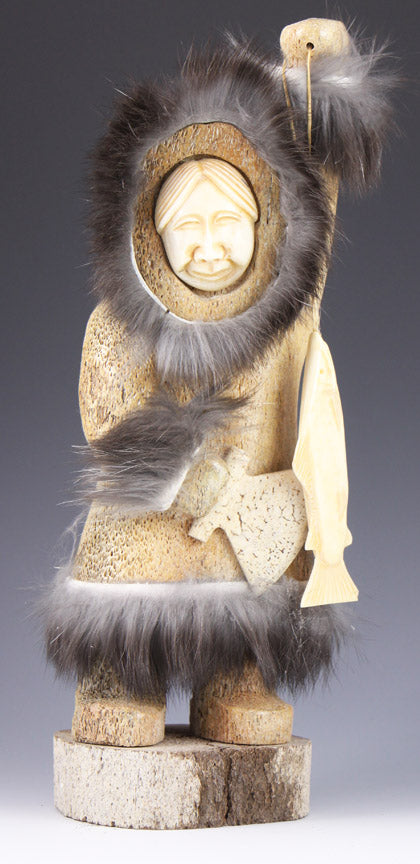 Eskimo Woman with Salmon and Ulu Knife