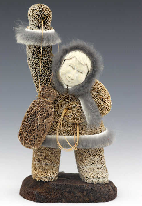 Eskimo with Hunting Float Carving